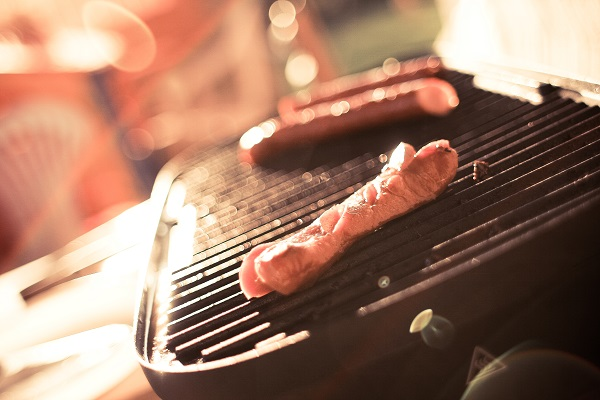 Three Sausages On A Grill