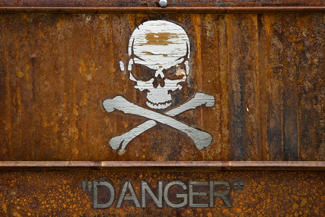 Rusted skull and cross bones danger sign